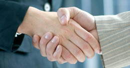 Photo of handshake.  Link to Membership page